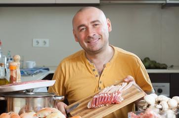 man preparing meat