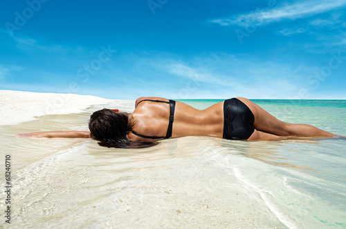 canvas print picture Woman lying on a dreamy beach
