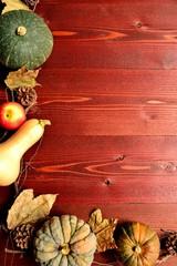 Pumpkins on brown wooden background