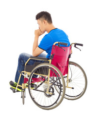 handicapped man sitting on a wheelchair and thinking