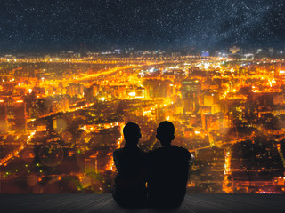 couple sit under sky