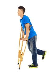 full length of  young asian man on crutches. white background