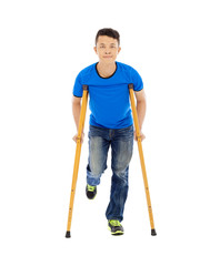 smiling Young asian man on crutches. white background