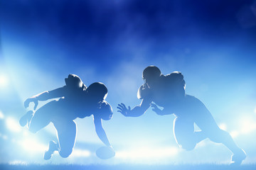 American football players in game, touchdown. Stadium lights