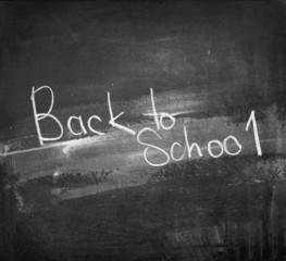 Back to School written on Black chalkboard