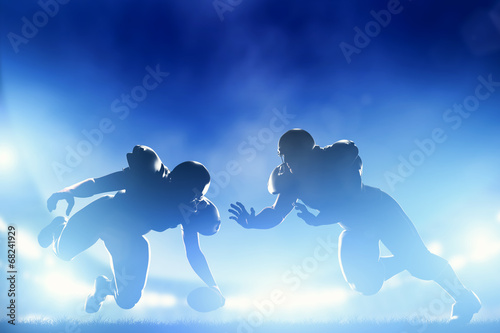 canvas print picture American football players in game, touchdown. Stadium lights