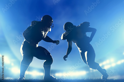 American football players in game, quarterback running. Game - 68241978