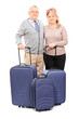 Mature couple posing with their baggage