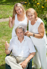 Elderly couple and their daughter