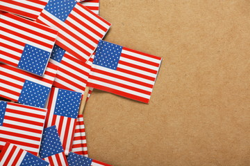 Flags of the United States on a cardboard background