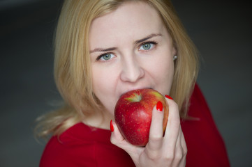 Vetrical - woman eating and biting apple