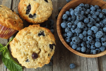 Blueberry muffins on wooden board