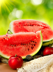 Juicy ripe organic watermelon closeup over nature background