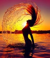 Beauty model girl splashing water with her hair