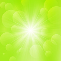 Shiny Sun on green background