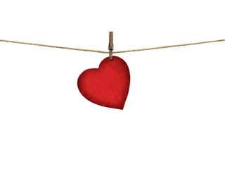 Valentine card heart shaped from old red paper hanging on a clot