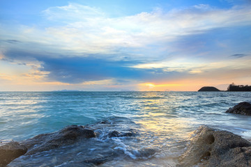 Panoramic dramatic tropical sunset sky and sea with rock surface