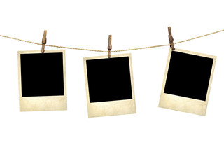 Old style photographs hanging on a clothesline