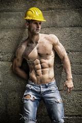 Handsome construction worker standing
