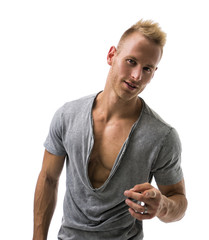 Fit male model smiling and pointing
