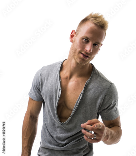 canvas print picture Fit male model smiling and pointing