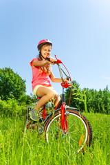 Nice teenage girl on bicycle
