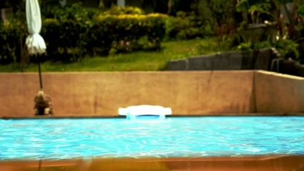 Swimming pool Water. Sunny Summer Vacation Day.