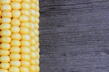 Corn on old wood background. Close up