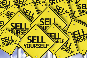 Sell Yourself written on multiple road sign