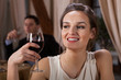 Woman drinking wine in restaurant