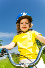 Pretty little girl on a bicycle