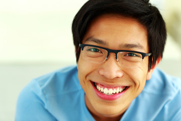 Closeup portrait of a happy asian man