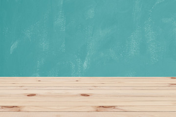 Wooden floor and green retro wall background