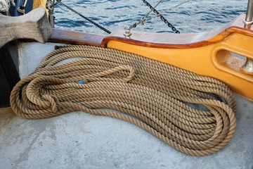 Coiled ropes on the deck of a sailing ship