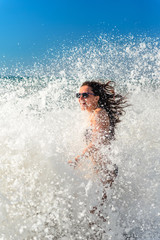 Girl bathes in a storm at sea, laughter, joy