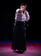 Aikido fighter on black