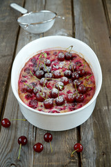 Clafoutis with cherries in the baking dish