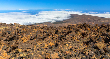 Petrified lava and a fog bank at the top of the Teide volcano