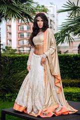 Indian bride stands in the garden
