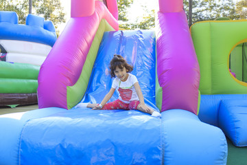 Girl on the trampoline slide