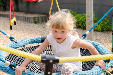 blond girl on playground