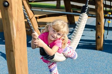 blond girl on playground