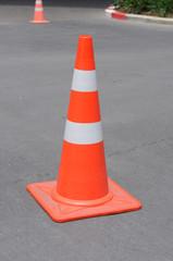 Orange traffic cone at park.