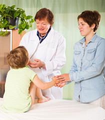 doctor examining preschooler child