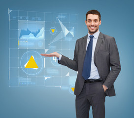 businessman showing graph on virtual screen