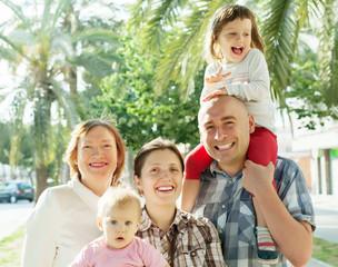 happy three generations family in summer
