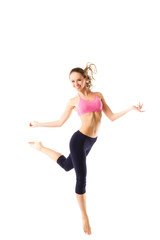 Beautiful sporty woman jumping on a white background