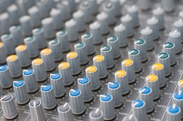 Detail view of music mixer with knobs