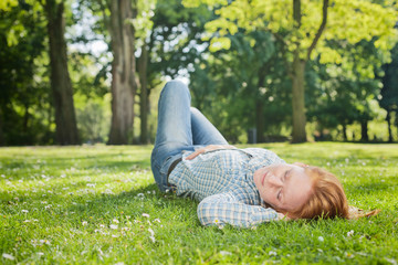Woman Takes a Nap in a Park