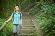 Active Woman Explores a Forest
